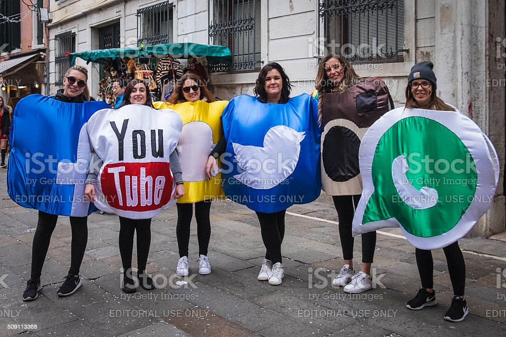 Carnival revellers dress up as social media for Mardi Gras stock photo