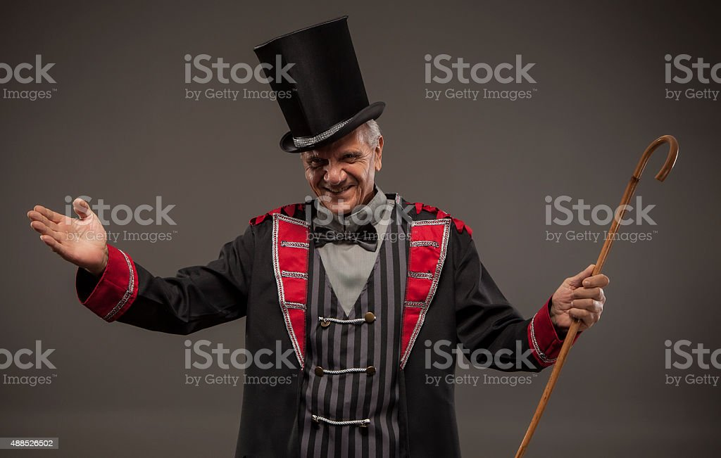 Carnival ticket salesman with big top hat. stock photo