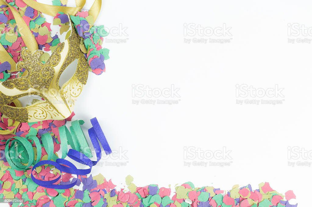 Carnival Venetian mask, confetti and streamers stock photo