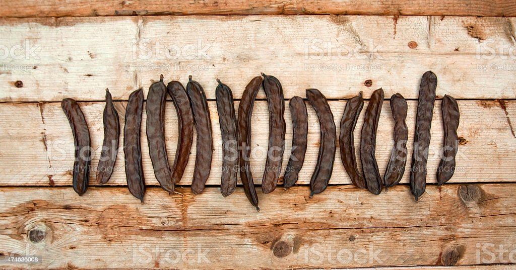 Carob  Beans , Wooden Background stock photo