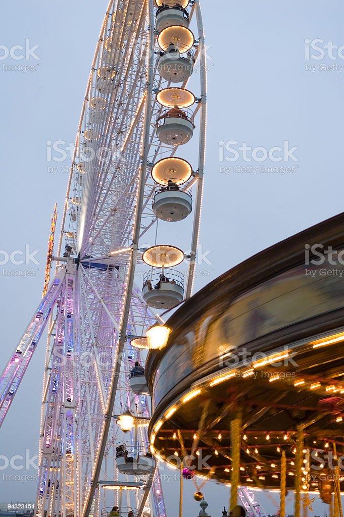 Carousel and ferris wheel stock photo