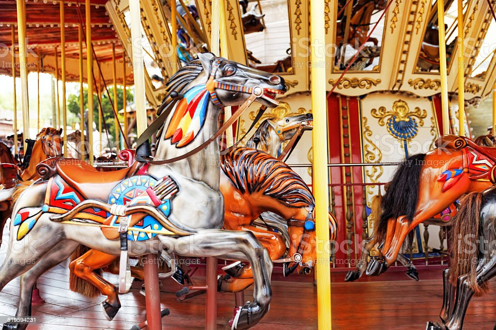 Carousel. Horses on a carnival. stock photo