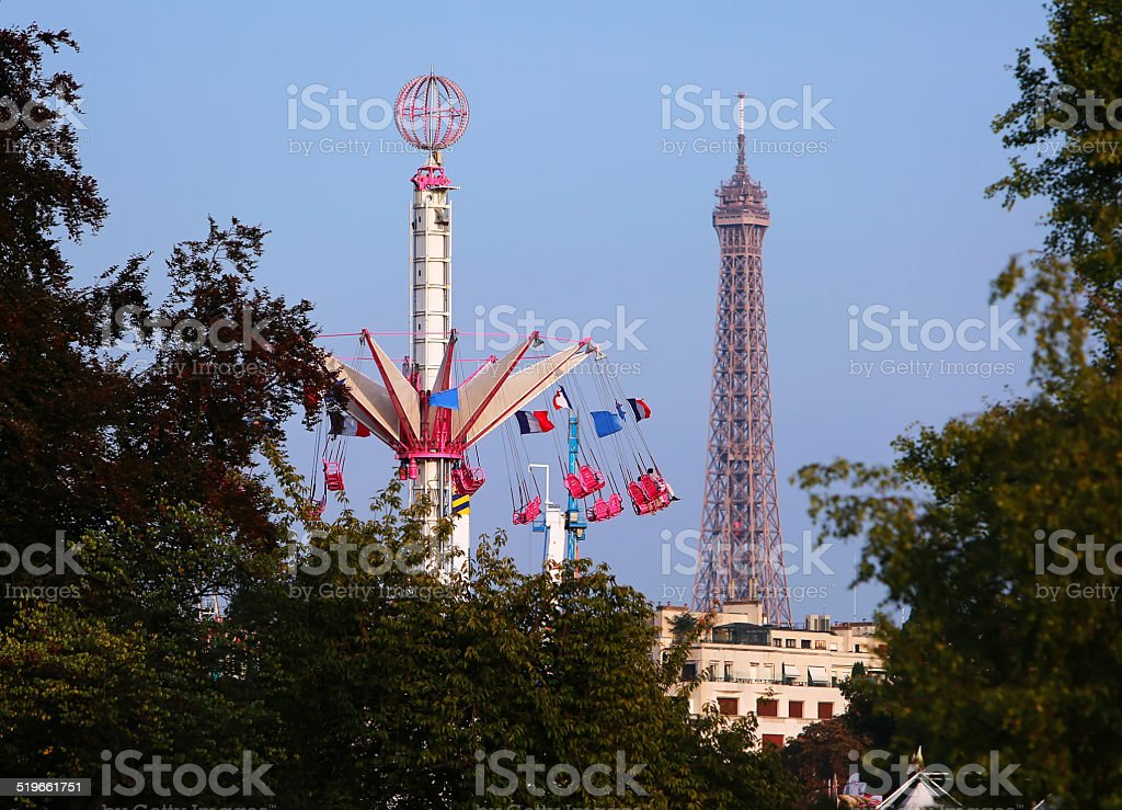 Carousel in front of the Eiffel Tower in Paris stock photo
