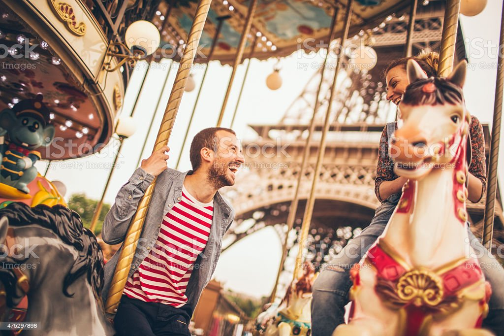 Carousel ride under the Eiffel Tower stock photo