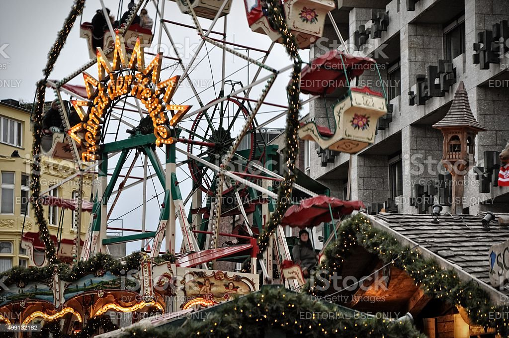 Carousel rotating at Christmas market fair in Cologne, Germany stock photo