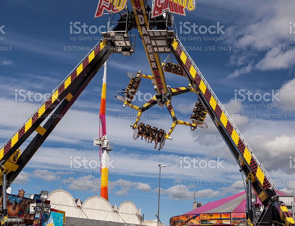 Carousel with a group of persons taking a ride stock photo