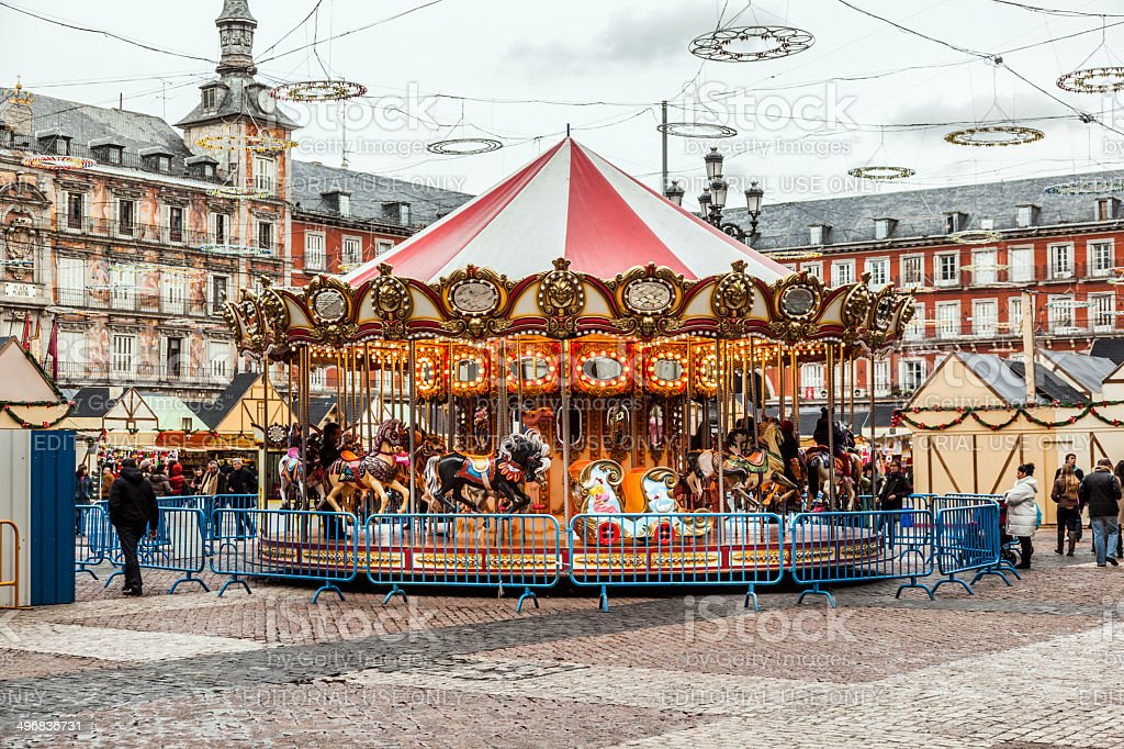 carousell for children in the evening at plaza de Mayor stock photo