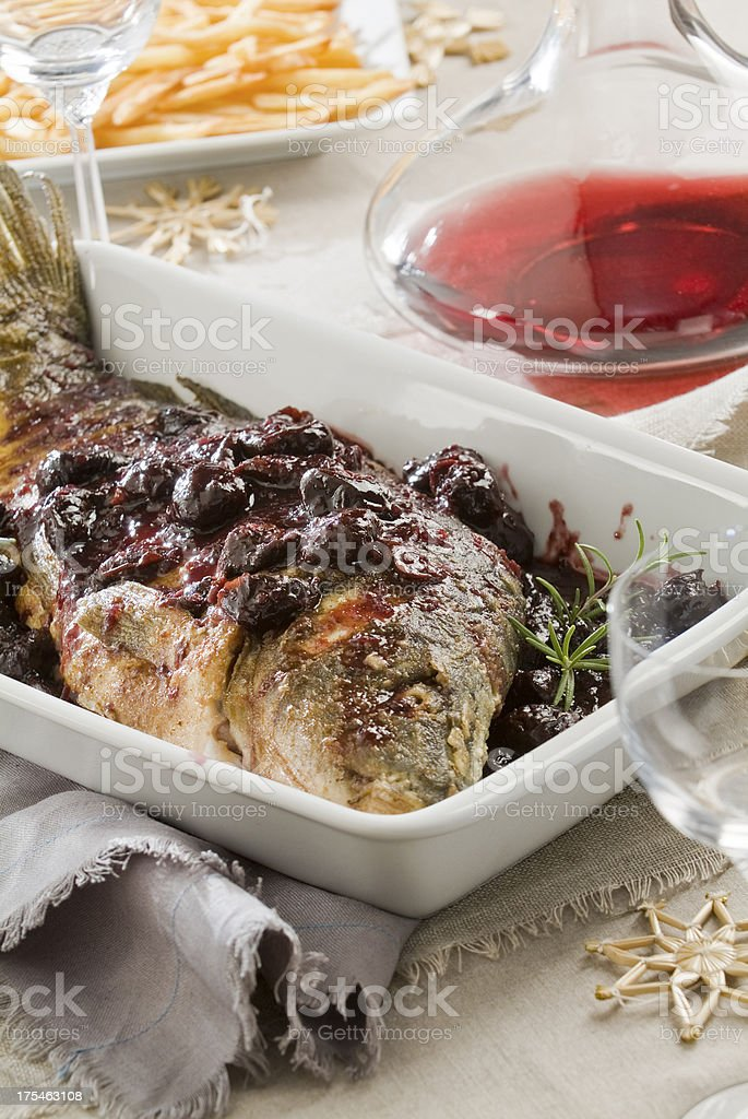 carp baked with plums stock photo