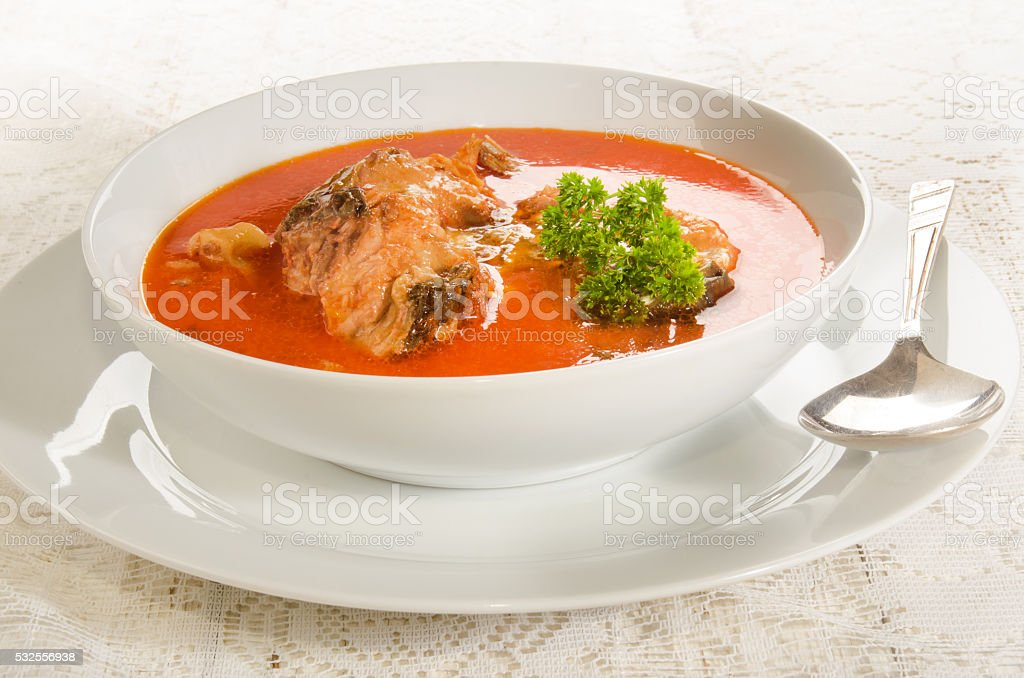 carp soup with sour cream in a white soup plate stock photo