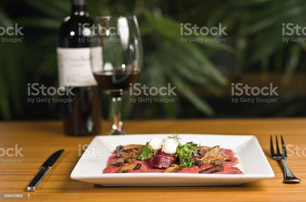Carpaccio and red wine stock photo