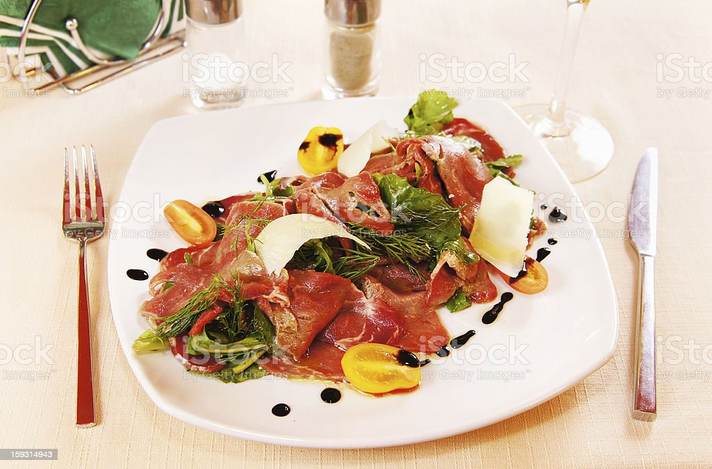 Carpaccio charcuterie  on a plate royalty-free stock photo