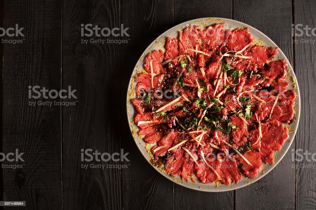 Carpaccio of beef on a plate stock photo