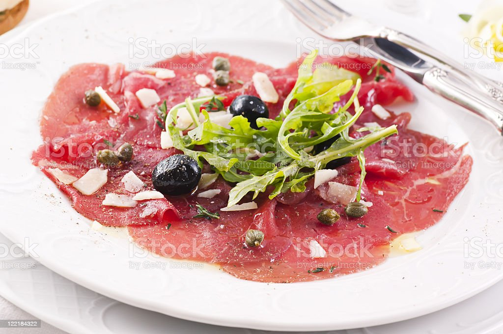 Carpaccio with olives and Parmesan stock photo