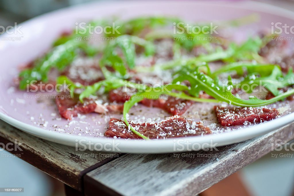 Carpaccio with sallad and parmesan cheese stock photo