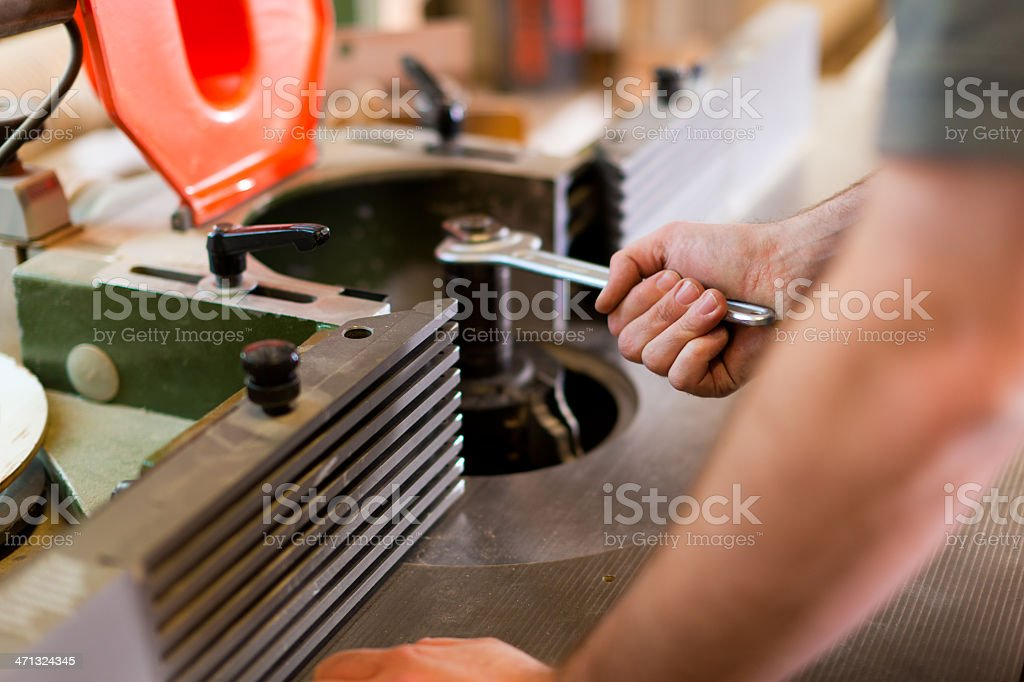Carpenter adjust cutter royalty-free stock photo