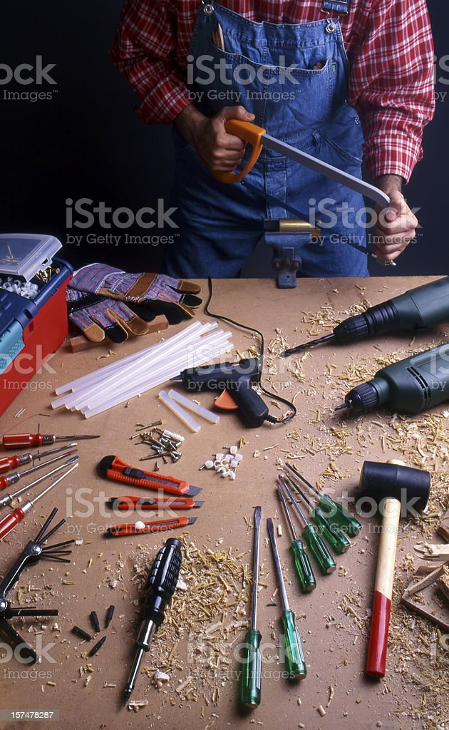 Carpenter and toolbox royalty-free stock photo