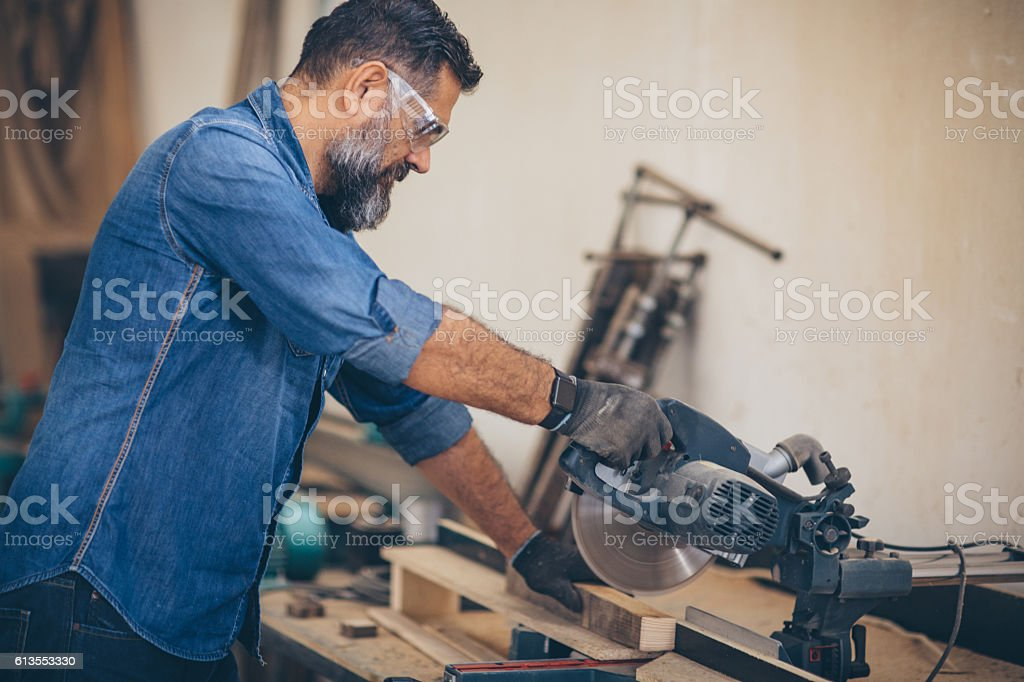 Carpenter at his happy place stock photo