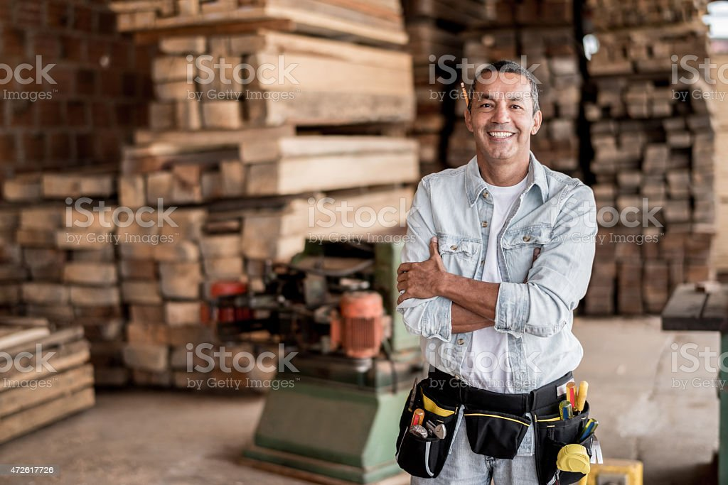 Carpenter at his workshop stock photo