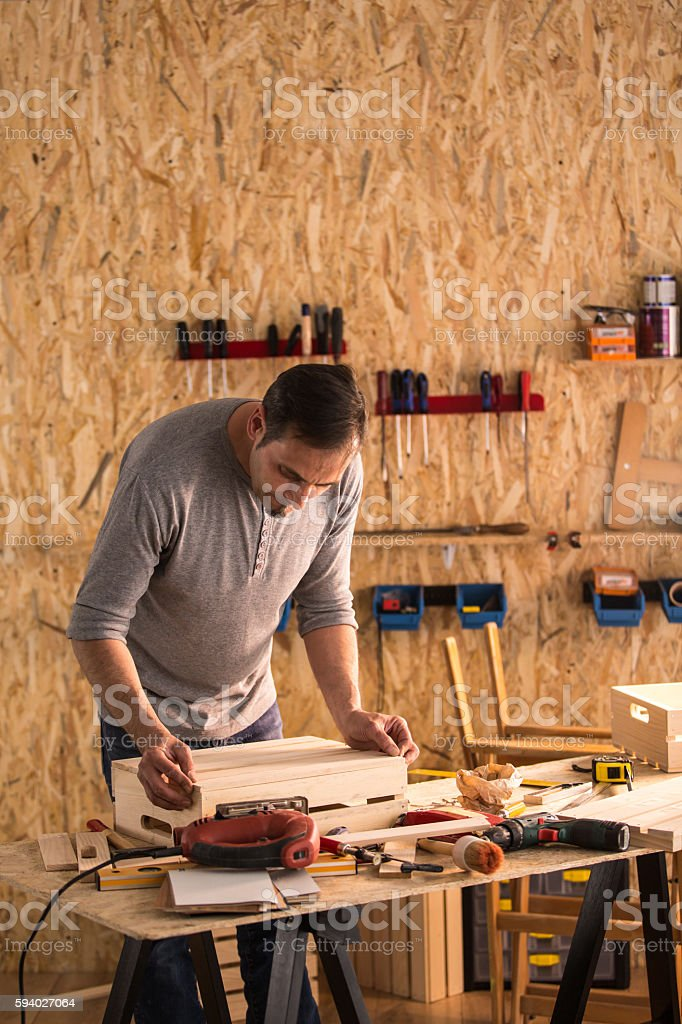 Carpenter at work in his woodshop stock photo