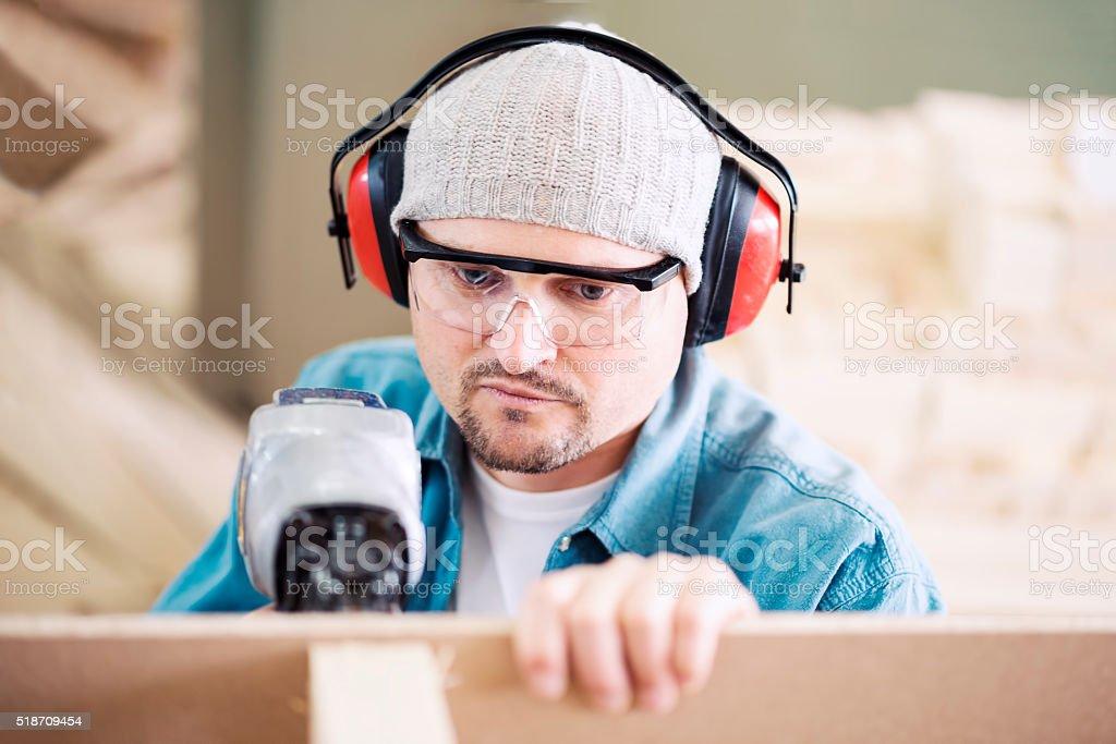 Carpenter at work stock photo