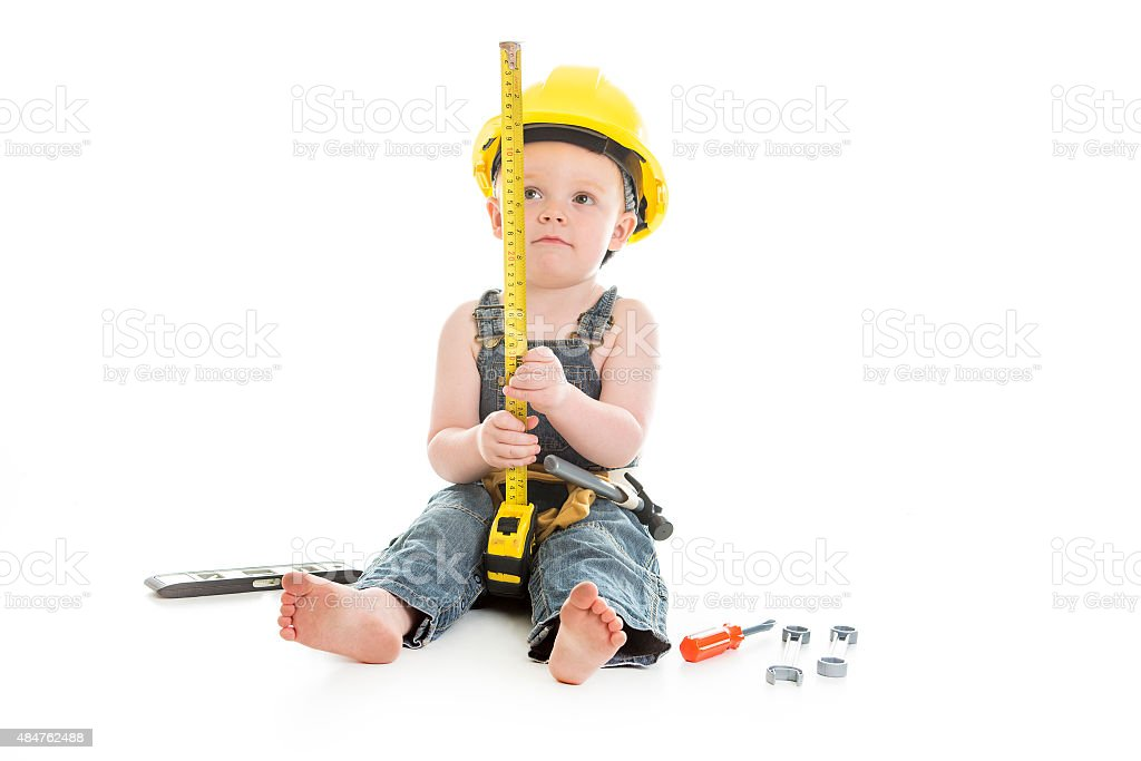 carpenter baby boy portrait over a isolated white background stock photo
