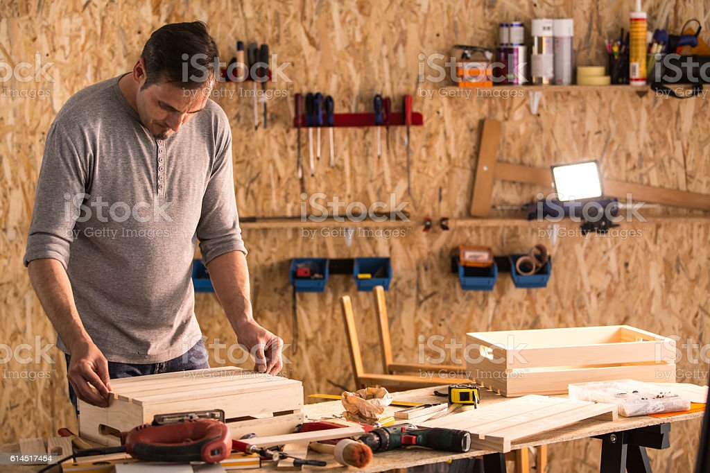 Carpenter building wooden product in workshop stock photo