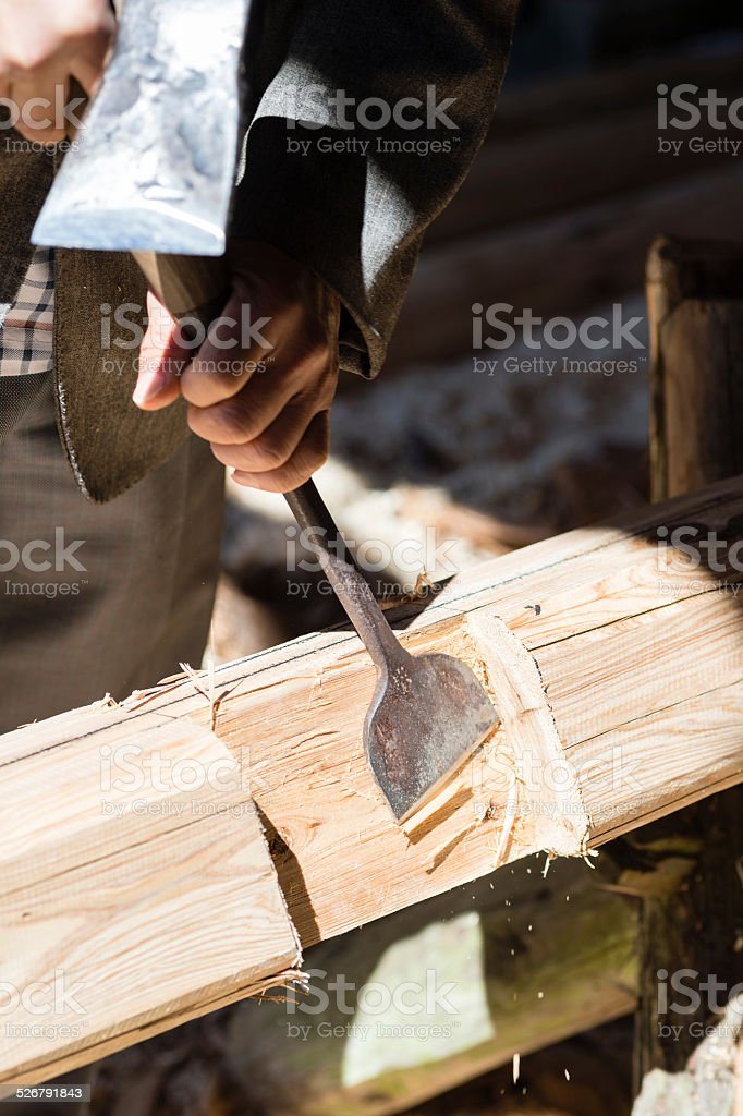 Carpenter Carving Wooden Plank stock photo