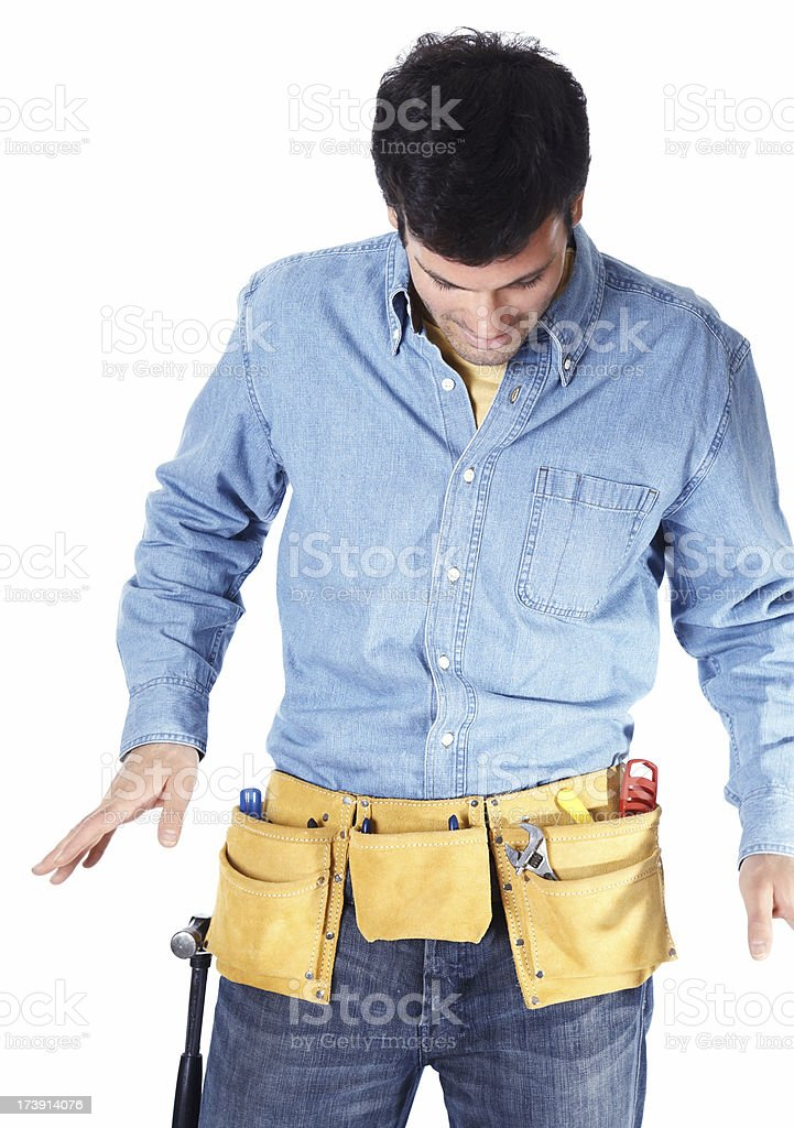 Carpenter checking his tool belt and  isolated on white background royalty-free stock photo