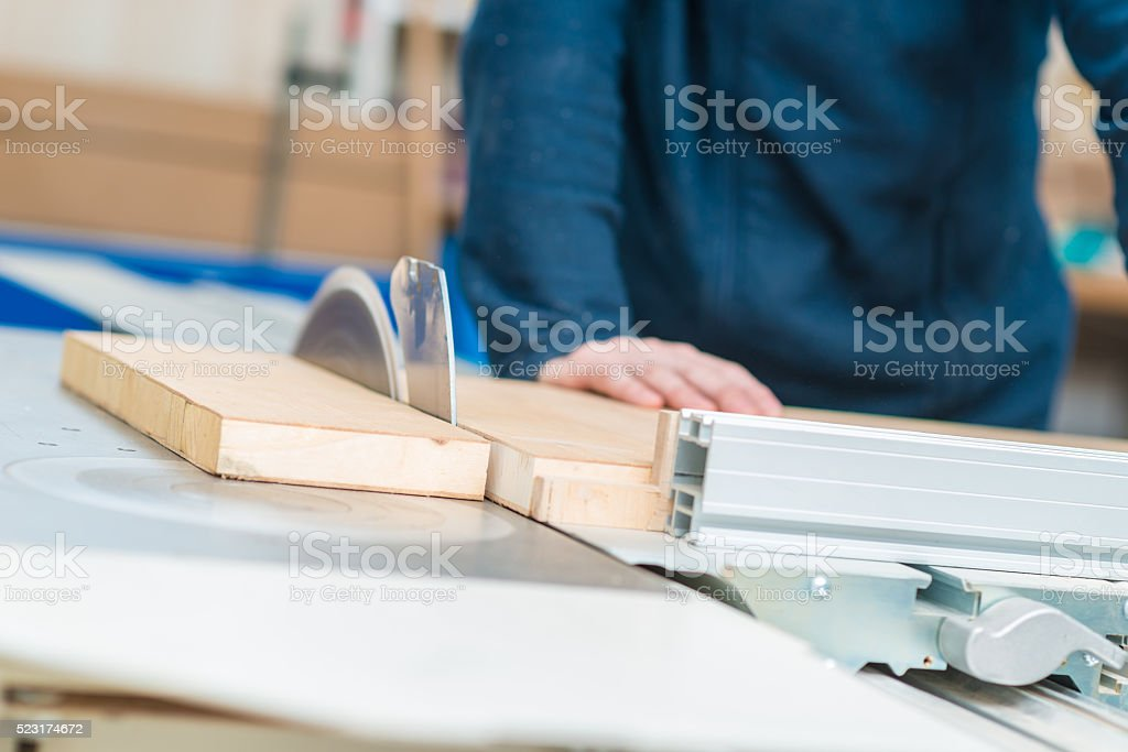 Carpenter cutting a Board stock photo