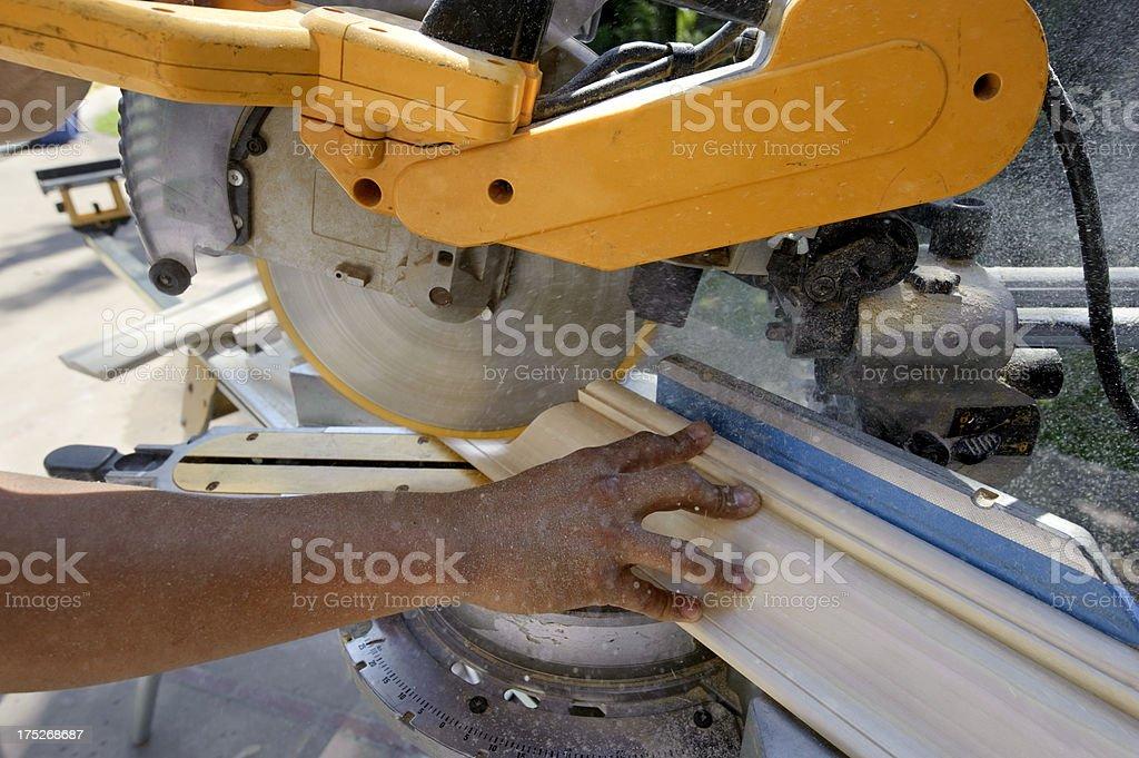 carpenter, cutting molding, miter-saw royalty-free stock photo