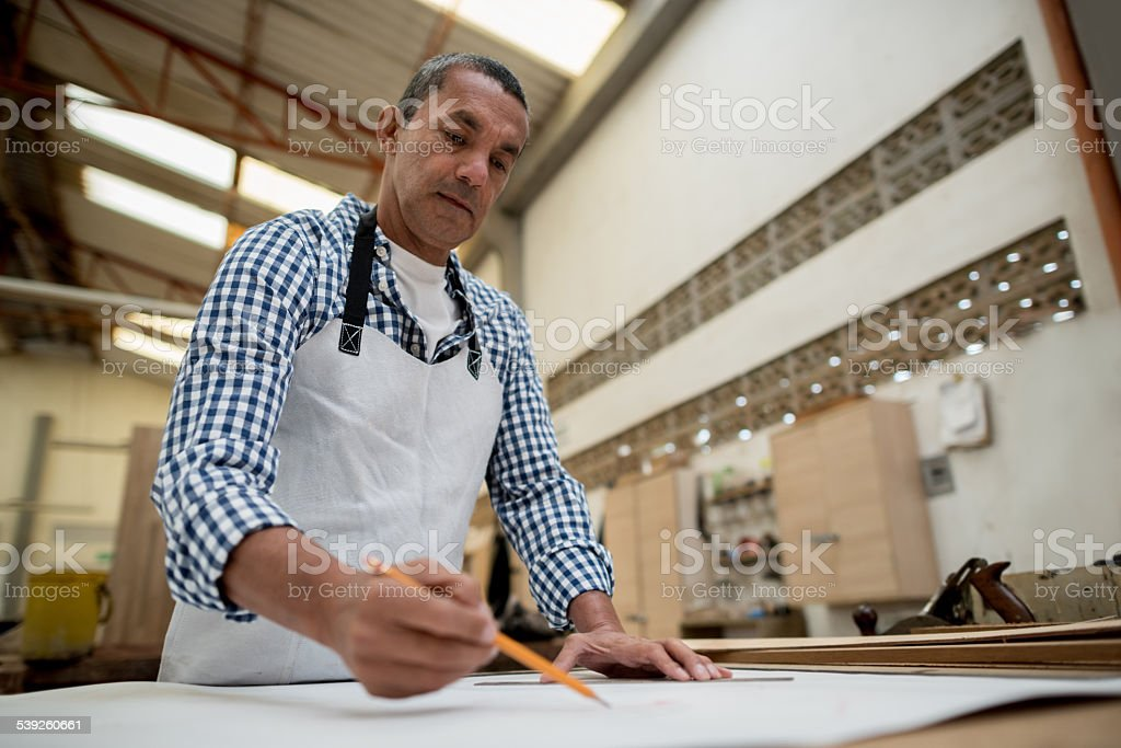 Carpenter drawing sketches stock photo