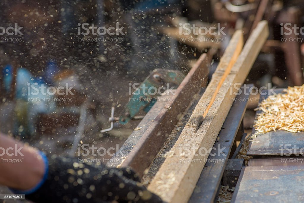 carpenter engaged in processing stock photo