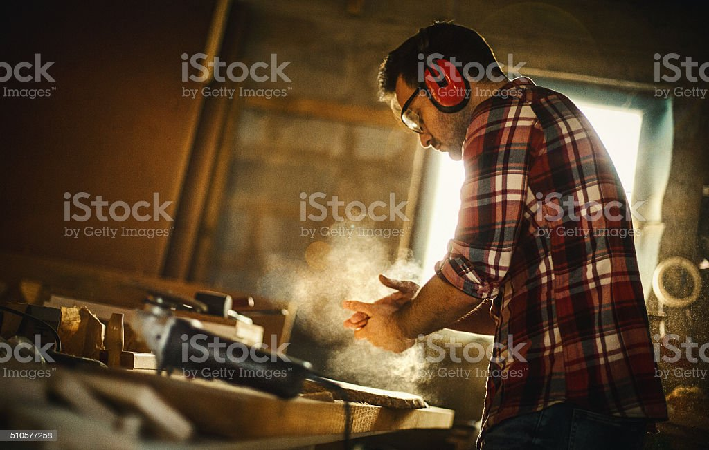 Carpenter finishing work. stock photo