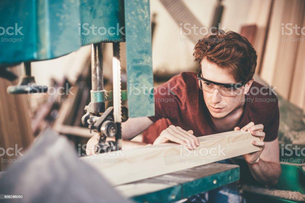 Carpenter focused on his work stock photo