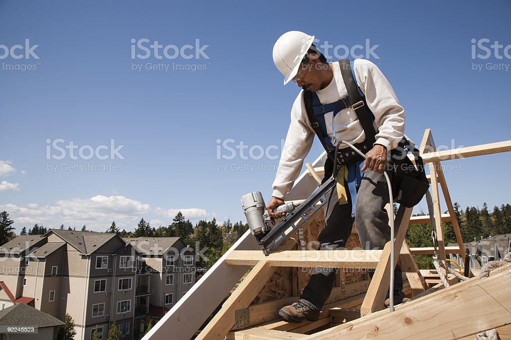 Carpenter Framing Partially Constructed Home royalty-free stock photo