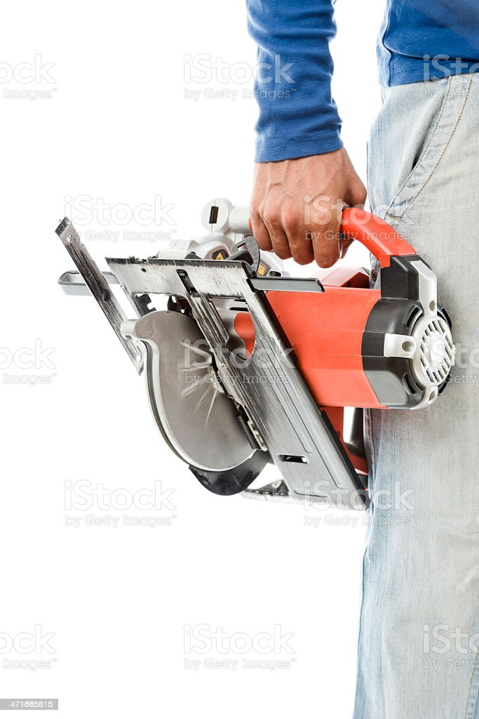 Carpenter Hand with Circular Saw royalty-free stock photo