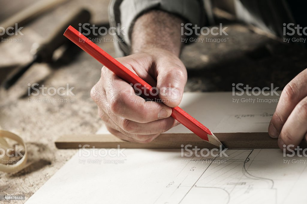 Carpenter hand's close up stock photo