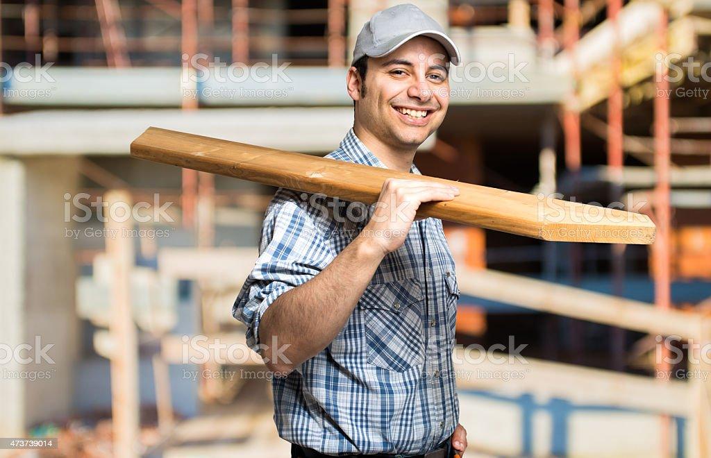 Carpenter in a construction site stock photo