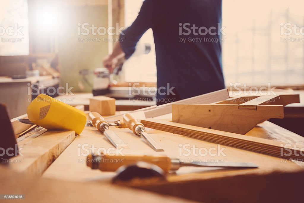 Carpenter in a construction workshop stock photo