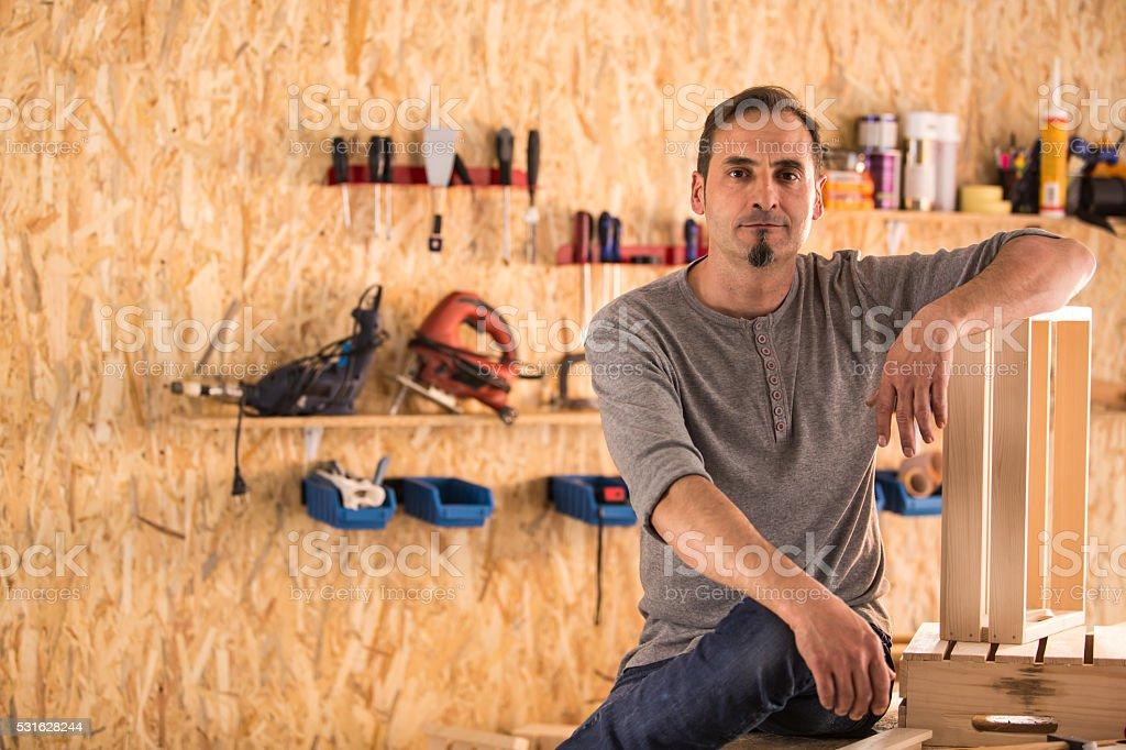 Carpenter in his furniture shop stock photo