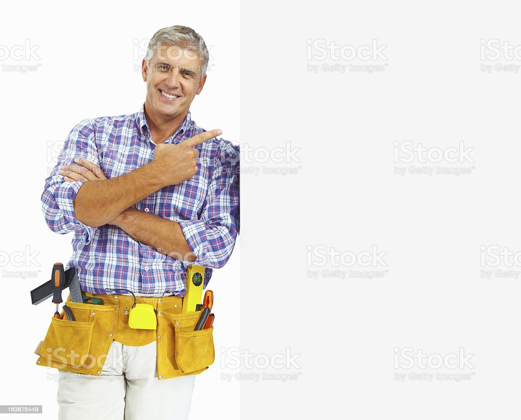 Carpenter in tool belt - copy space on white background royalty-free stock photo