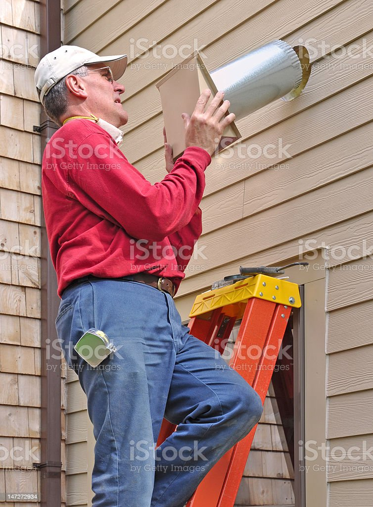 Carpenter installing vent royalty-free stock photo
