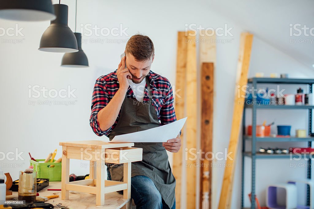 Carpenter Looking New Project in His Workshop. stock photo