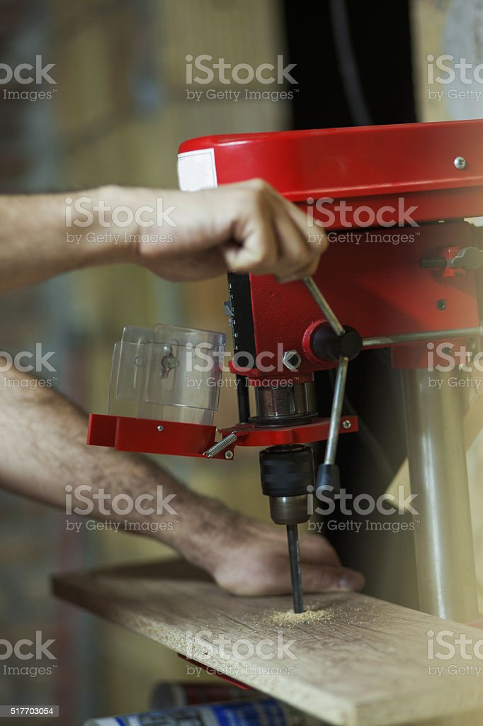 Carpenter making a hole with a drill stock photo