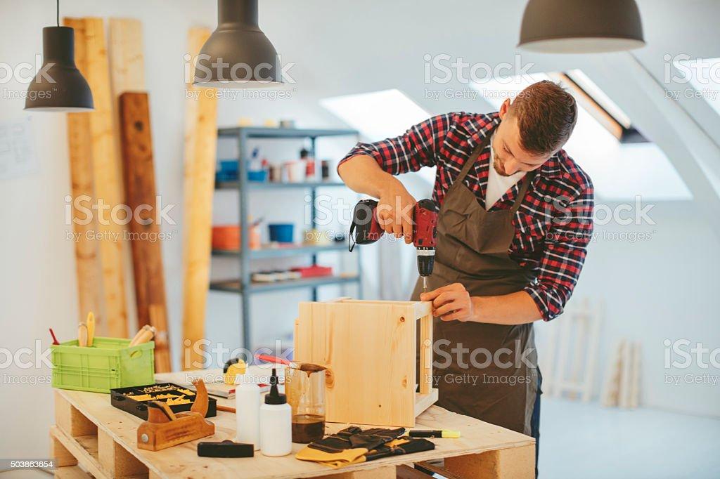 Carpenter making chair stock photo