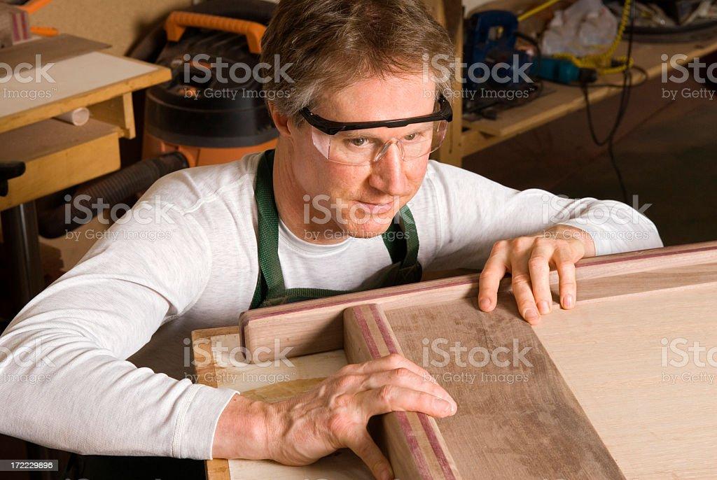 Carpenter Making Furniture in Workshop royalty-free stock photo