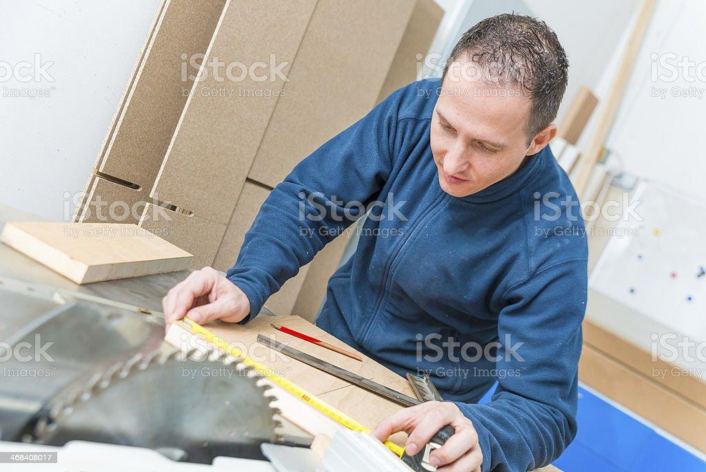 Carpenter making mesurements royalty-free stock photo
