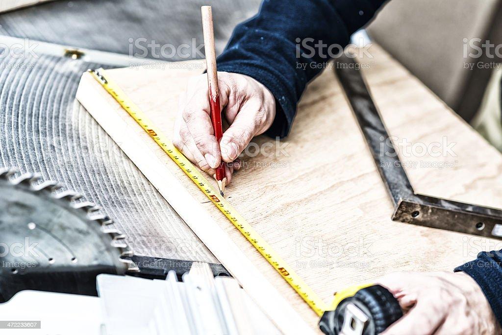 Carpenter making mesurements stock photo