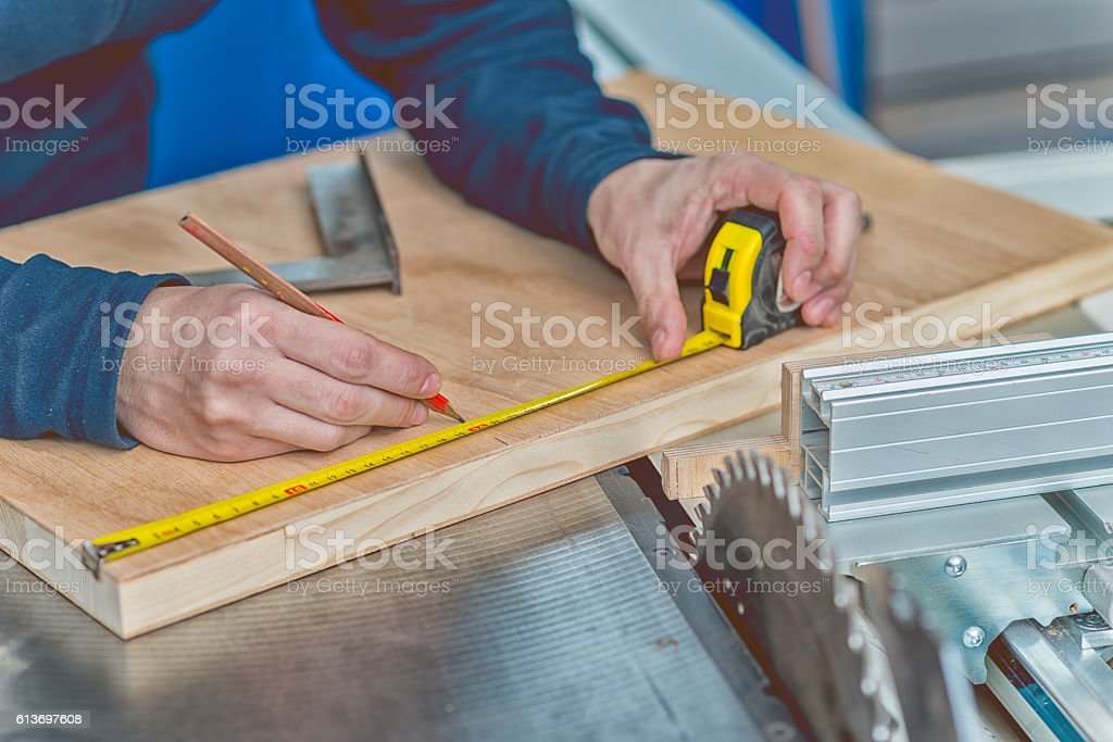 Carpenter making mesurements stock photo