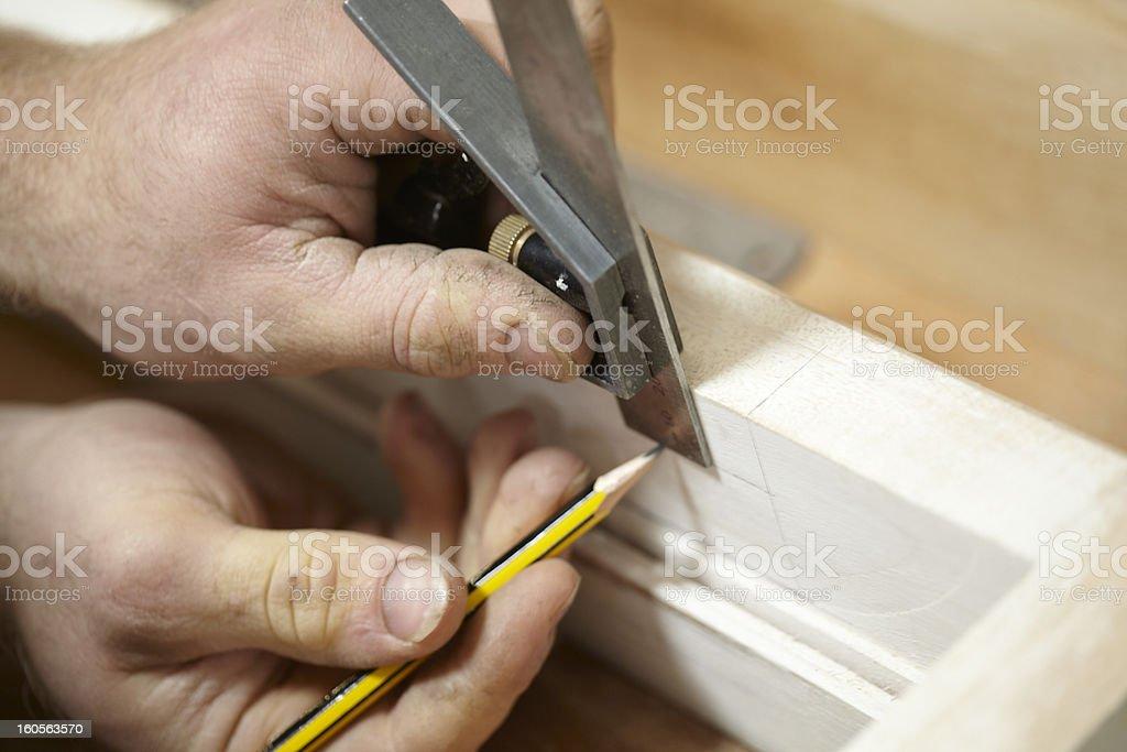 Carpenter Making Victorian Style Cupboard In Workshop stock photo